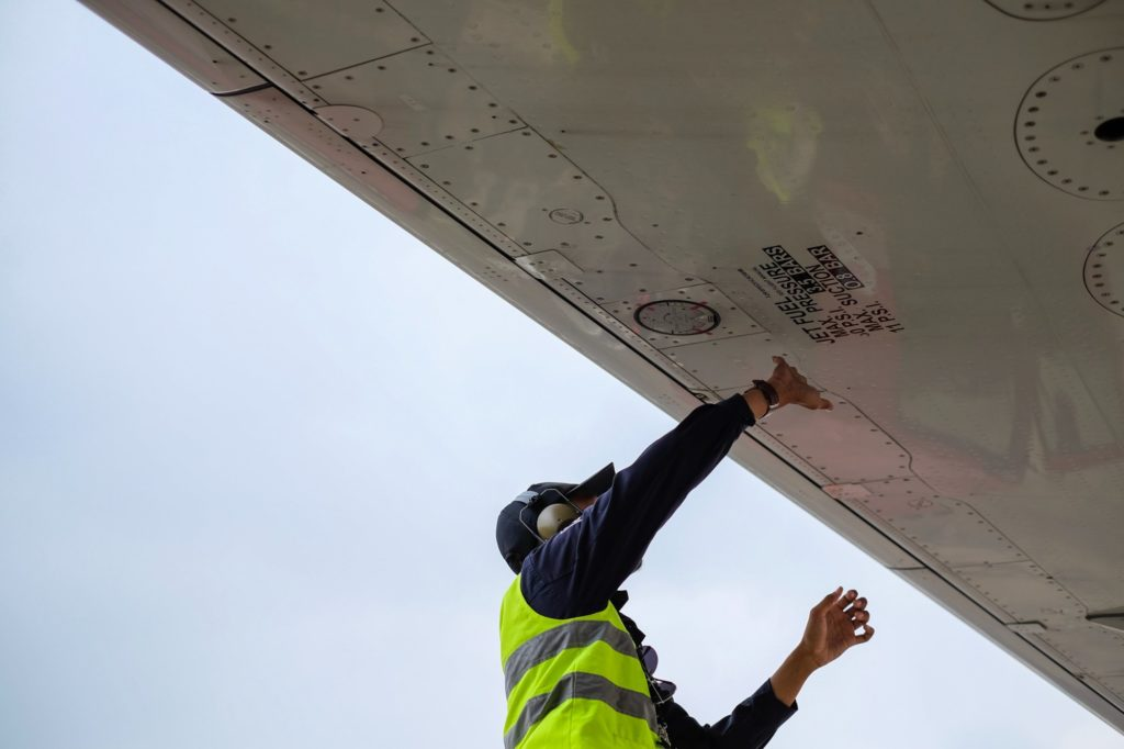 Maintenance checks being conducted on an aircraft
